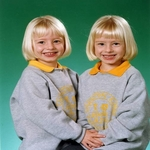 two smiling little blonde girls